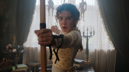 Young woman hold a bow and arrow