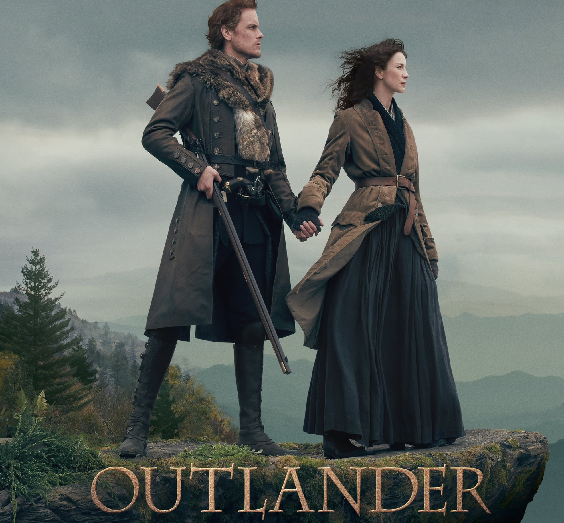 Title: Outlander below a picture of a man and woman standing together on a ledge