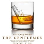 Title: The Gentlemen underneath a glass of whisky with a gun shaped ice cube