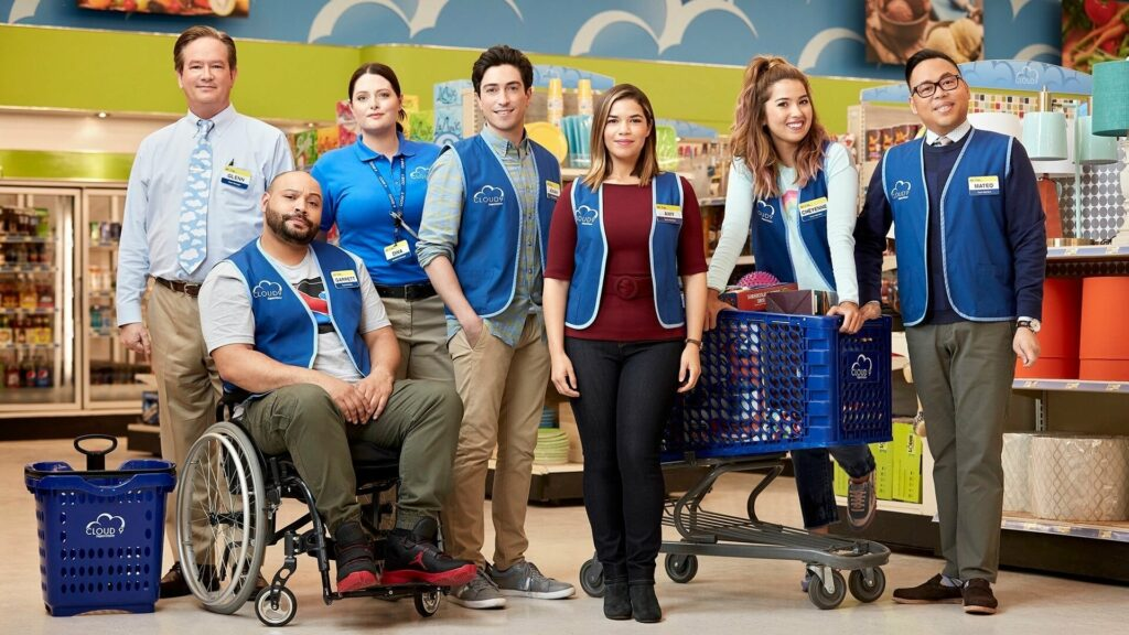 A group of blue-vested store employees standing together
