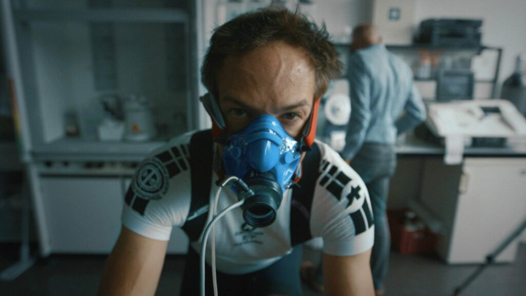 Man wearing an oxygen mask on in a medical lab