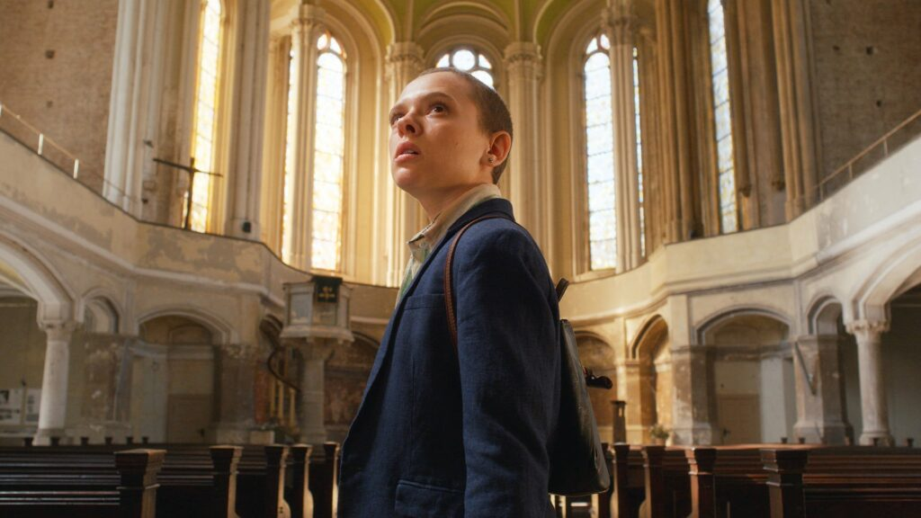 A young woman standing in a cathedral