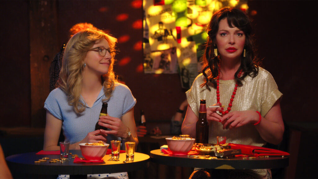 Two women sitting in a bar together