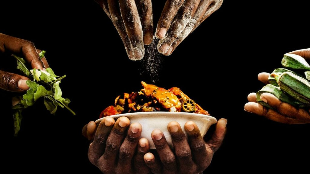 black hands holding a bowl of food with other hands adding to the bounty
