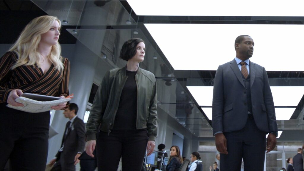 Two women and a man standing in the lobby of the FBI headquarters