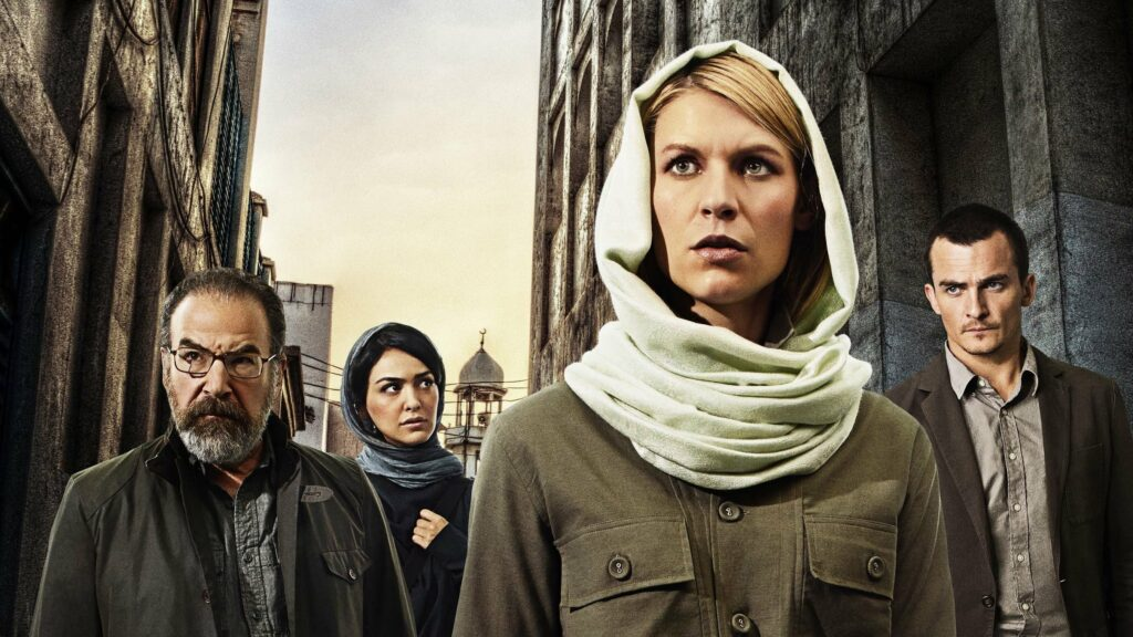 Four people standing in a bombed out street in the middle east