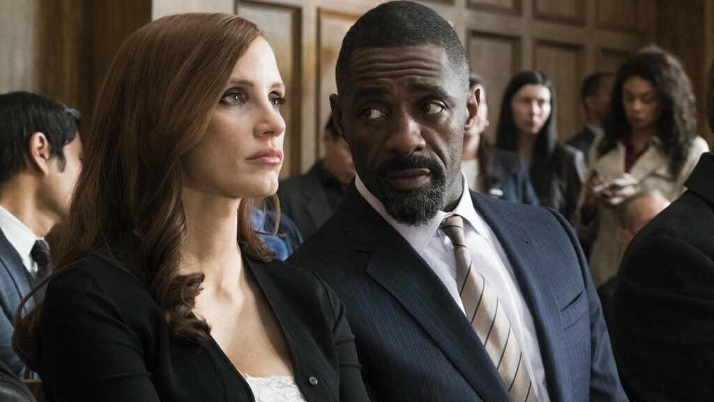 A man and a woman sitting in a courtroom together