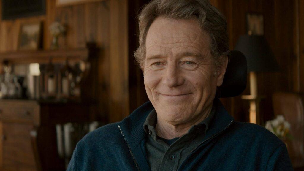 A man, in a wheelchair, smiling