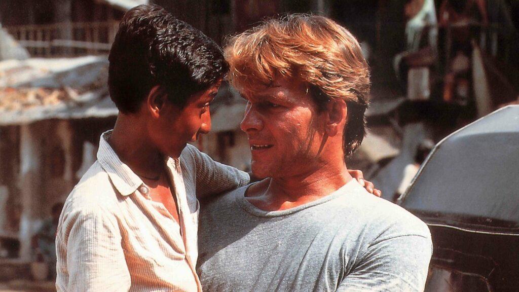 An American man holding a little Indian boy