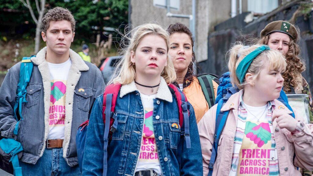 Four teen girls and a teen boy, wearing matching t-shirts