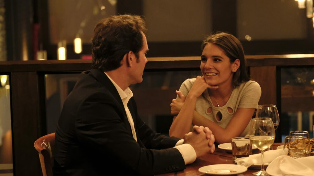A man and a woman eating supper together at a restaurant