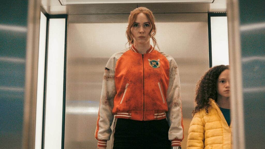 A young woman and a little girl in an elevator