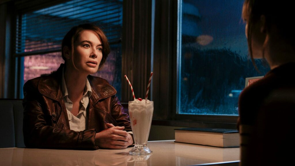 Two women sitting in a diner