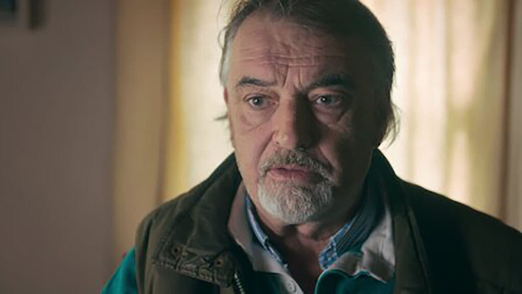 Prime suspect, Ian bailey - a 50-something year old man sitting in a darkened room