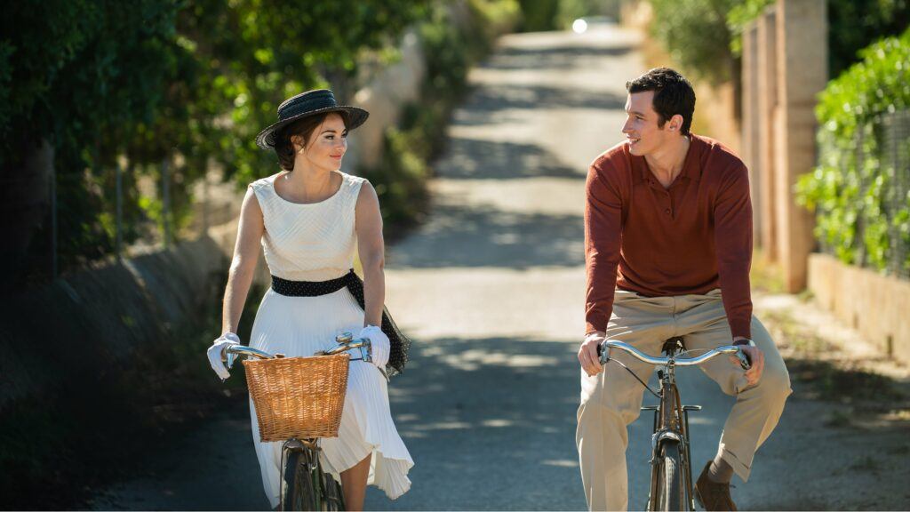 a man and woman riding bikes together