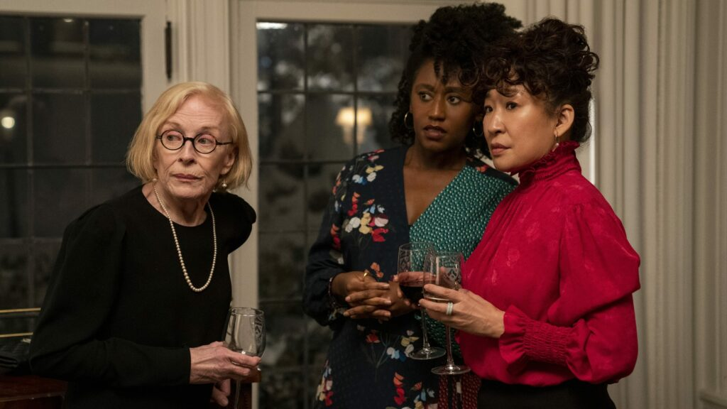 Three women standing together at a cocktail party