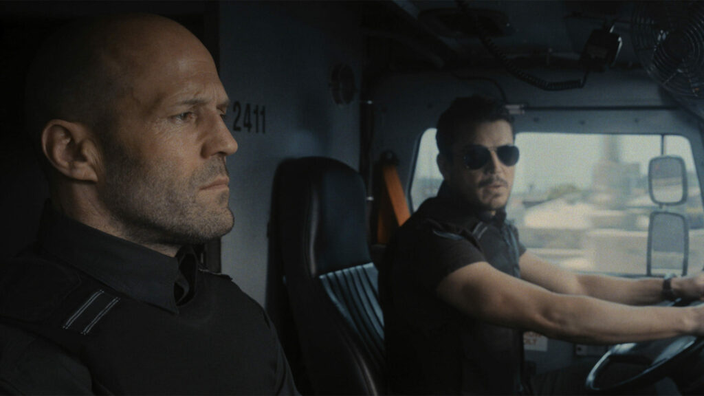 Two men sitting in an armored truck