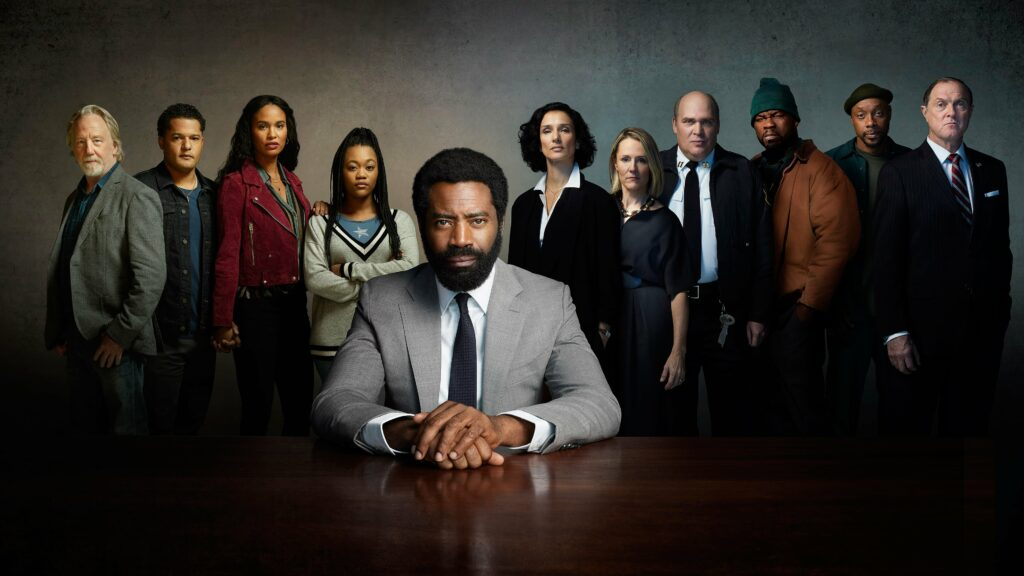 The full cast of For Life standing behind lead actor Nicholas Pinnock