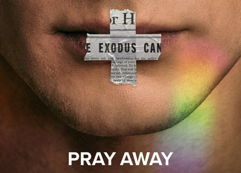 a close up of a man's face. He has tape over his lips and the words 'pray away' are written across the bottom of the picture